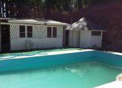 Vendo hermosa parcela de 10.000 m2 con casa y piscina.