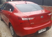 Vendo excelente kía motors río 4 2013 color rojo