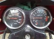 Vendo excelente moto storm roja 125 cc 2008
