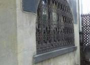 Casa, fachada declarada patrimonio.
