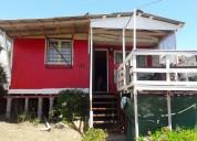 Vendo casa en quintero barata con tres dormitorios y terraza con vista al mar.