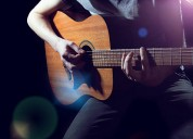 Clases de guitarra niños jóvenes y adultos a domicilio