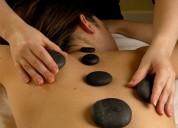 Masaje descontracturante  con piedras calientes