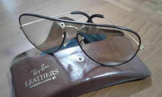 gafas rayban cristal fotocromaticos ,marco bañados en oro y forrados con LEATHERS (cuero)