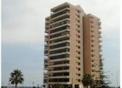 Arrienda depto. edificio atalaya playa cavancha 2d