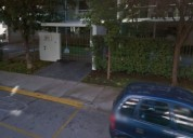 Estacionamiento frente al parque arauco .