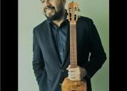 Clases de lenguaje musical armonia solfeo ejecucion instrumental guitarra cuatro bajo en santiago
